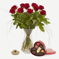 Red roses with chocolate filled metal heart